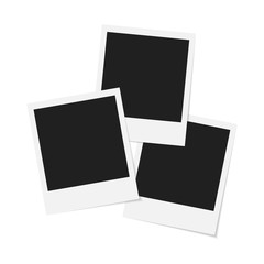 Three blank polaroid pictures with shadow isolated on white background. Empty picture frames.