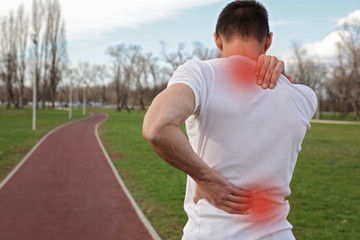 Sport injury, Man with back pain. Pain relief and health care concept.