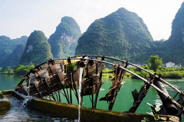 Old wooden water mill in Yangshuo Li river
