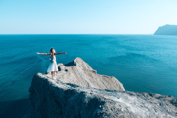Girl standing on the mountain top