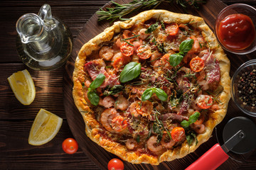 Delicious homemade fresh pizza with shrimps and bacon. Top view