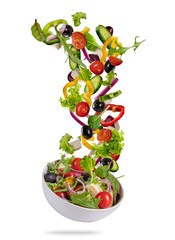 Flying vegetable greek salad isolated on white background