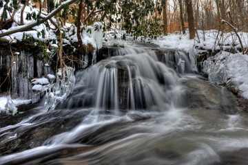 Small stream waterfall in winter