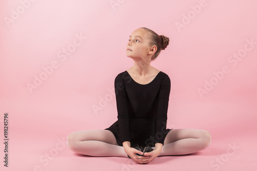 5dd949d3e00f1f Portrait of young beautiful child girl ballerina practicing ballet ...