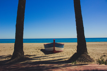 Boat. Lonely boat on the beach in Estepona.