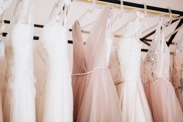 details of a wedding dress hanging on a hanger