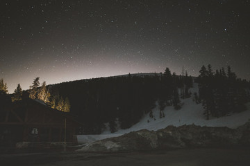 Mountain against starry sky at night