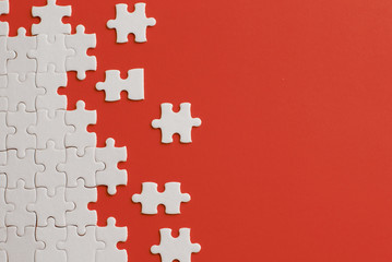 Wall Mural - White details of puzzle on red background