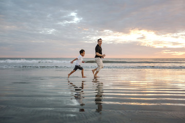 Father and son enjoying beach
