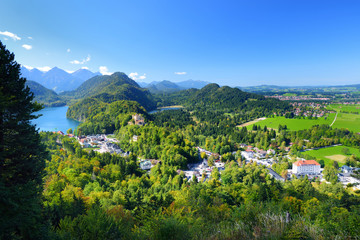 Fototapete - Famous Hohenschwangau Castle on a rugged hill above the village of Hohenschwangau near Fussen in southwest Germany