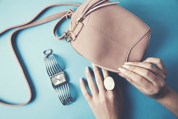 Woman hand fashion bag, ring and watch