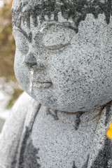 Statue in snow; Buddha in snow