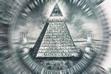 Conspiracy theory concept. All Seeing Eye and Pyramid on USA dollar banknote, macro photo
