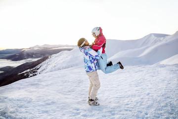 Happy couple having fun at snowy ski resort. Winter vacation