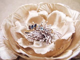 Woman golden rings garnet topaz jewelry jewellery fabric silk peony flower macro photo