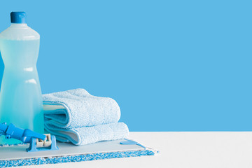 Foto op Aluminium Spa Professional cleaning set for different floor surfaces in kitchen, bathroom and other rooms. Empty place for text or logo on blue background. Cleaning service concept. Early spring regular clean up.