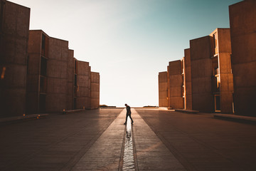 Man walking between architecture
