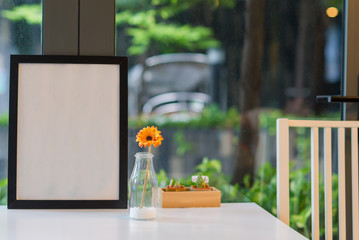 Beautiful gerbera flower in bottle glass with phhoto frame interior decoration
