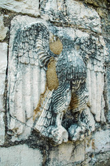 Fototapete - Relief of an eagle on ancient wall