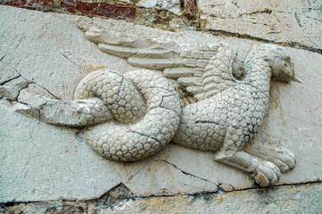 Fototapete - Relief of a dragon on ancient wall