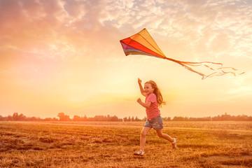 child running flying kite