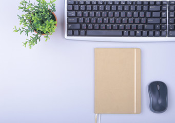 Modern office table with keyboard, phone, notebook on white background top view mock-up. copy space