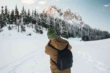 Professional photographer taking photos from a  snow covered trees and mountains