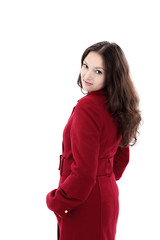 beautiful young woman in a red coat .isolated on white