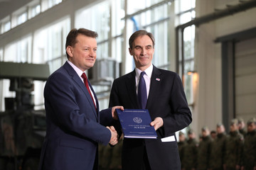 Polish Defence Minister Mariusz Blaszczak and U.S. Ambassador to Poland Paul W. Jones attend the signing ceremony for a deal to buy Raytheon Co'sPatriotmissiledefencesystem in Warsaw
