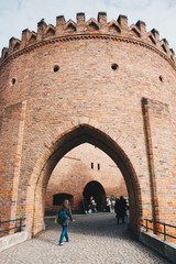 WARSAW, POLAND - Mar, 2018 Entrance of Historic Warsaw Barbican, a medieval fortification in Warsaw center- Poland.