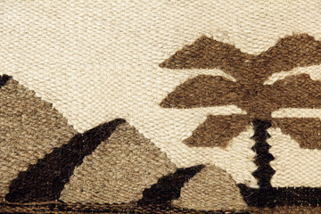 The Camel wool fabric pattern with Egyptian pyramids silhouette.