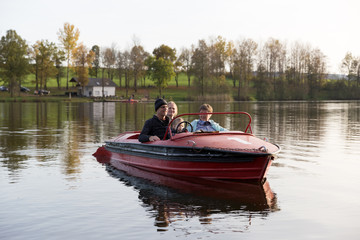 Grandparents and mother in a boat on the lake with child