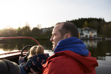 Father with child on the water in boat