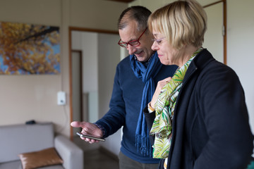 Senior couple viewing smart phone together