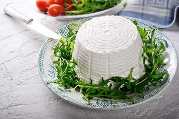 Ricotta cheese with arugula and tomatoes