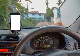 car and smart phone , using navigation app on smart phone.