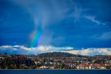 partial rainbow over the city