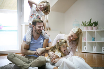 Young parents with daughters.