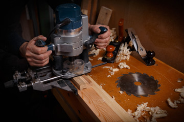 Carpenter working of manual milling machine in the carpentry workshop. Close up