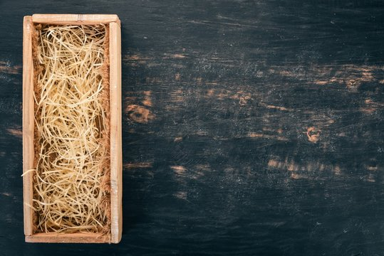 Wooden box for wine or brandy. On a black wooden background. Top view. Copy space for your text.