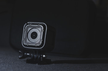 Close up look on action camera on grey background. A intimate lighting and detailed look with great depth of field.