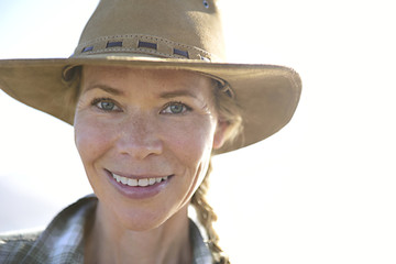 Portrait of smiling woman wearing a hat