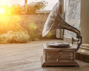 Beautiful silver vintage phonograph. Retro gramophone with copy space. Toned.