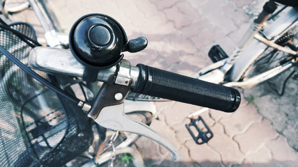 Hand grip black color and brake lever bicycles with old bell.  Components of the bicycle