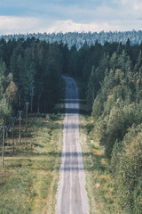 High angle view of road amidst trees in forest against cloudy sky