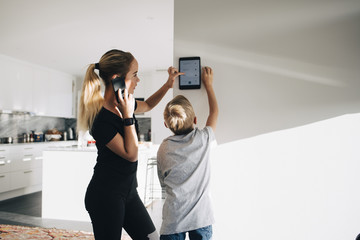 Brother and sister using smart home tablet