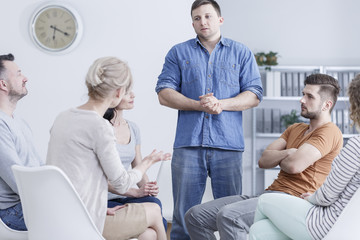 Man in intervention therapy meeting