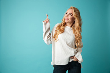 Portrait of a happy young blonde woman in sweater
