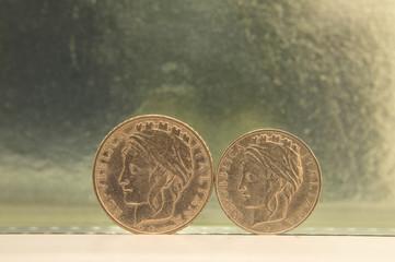 one hundred lire and fifty lire italian