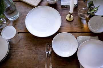 High angle view of empty plates on wooden table at home